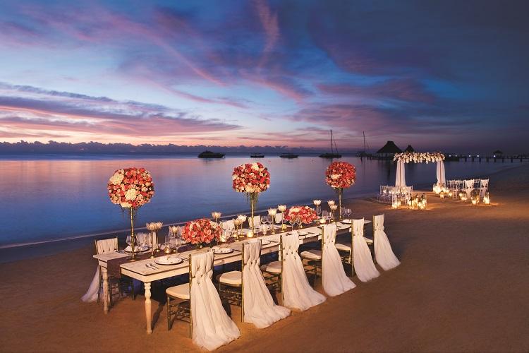 Beach wedding setup at Zoetry Paraiso de la Bonita in Mexico