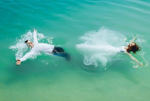 bride and groom in ocean