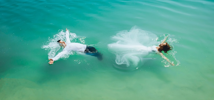 bride and groom in ocean