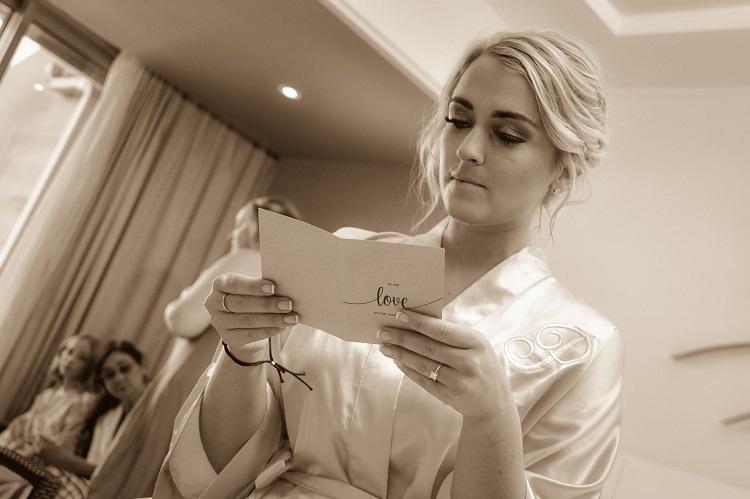 Bride reading love letter