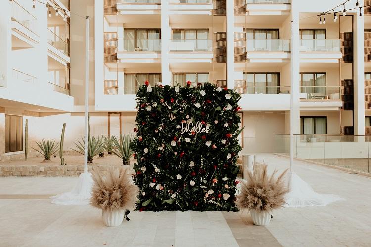 destination wedding reception floral wall