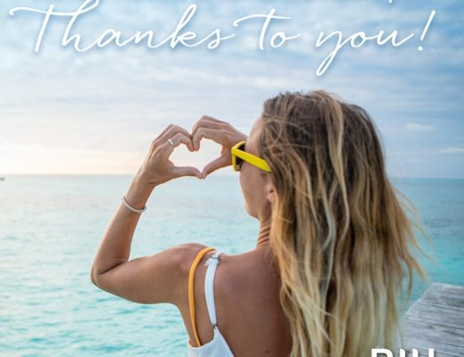 Traveler on beach making heart w/ hands